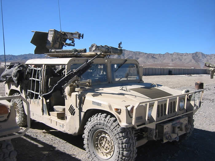 Third Group Hummer set up. They had a .50 Cal in the turret along with an AT4 hand fired MAL strapped behind the gunner for easy access. But they also had an additional machine gun mount for the guy riding shotgun to man. Mounted in the picture is a 240B. It replaced the M60. Marines call it a 240G. A variation of the weapon has been mounted in Bradley Fighting Vehicles for some time, called a 240C.  All are really Belgium FN MAG 58's. I test fired five MAG 58's against 5 PIGS. All five pigs went down after about 10,000 rounds. Not one MAG went down.