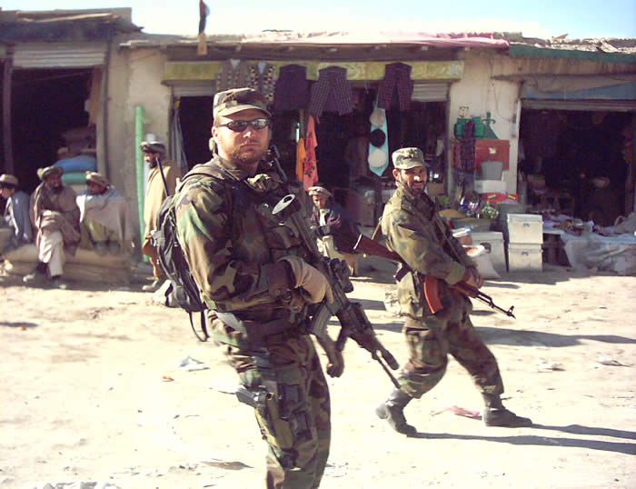 I was on foot patrol with the first battalion of the Afghan National Army (BANA).  A show of force as we just introduced the first Army to a forward operational area, town of Orgun, Paktia Province. Although US forces normally wore dessert Camy\'s I wore Standard BDUS since we issued those to the Afghanis and I was only one of two American\'s there. I didn\'t want to be sniper bait.