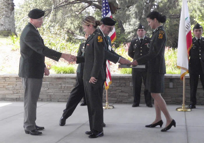 California State University Fullerton ROTC Battalion Professor of Military Science LTC Jonathan B. Nepute, Commanding - Lonny Holmes shaking hands with Cadet Jessica Villanueva, Brad Welker taking Special Forces Medal of Merit for presentation.