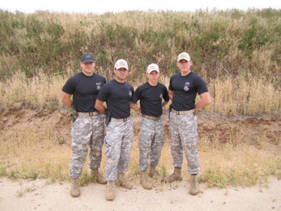Zach Hartley (left) who led the Titan Battalion in action pistol training with SF 78.